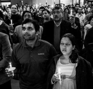 ALOK MADASANI, left, and his wife Reepthi Gangula hold candles during a vigil Feb. 26 at the Ball Conference Center in Olathe, Kansas, held in response to the deadly shooting Wednesday.