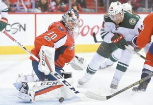 WASHINGTON CAPITALS goalie Braden Holtby (70) stops the puck against Minnesota Wild center Tyler Graovac (44) during the second period of an NHL hockey game on Tuesday in Washington.