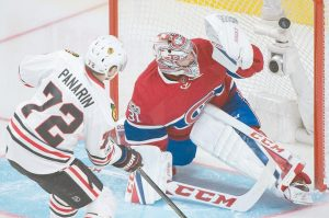 CHICAGO BLACKHAWKS' Artemi Panarin (72) scores on Montreal Canadiens goalie Carey Price during third period NHL hockey action in Montreal on Tuesday.