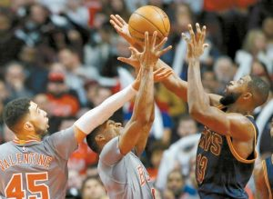 CLEVELAND CAVALIERS forward/center Tristan Thompson, right, battles for a rebound against Chicago Bulls guard Denzel Valentine, left, and guard Rajon Rondo during the second half of an NBA basketball game Thursday in Chicago.