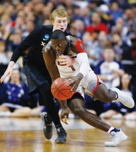 XAVIER GUARD J.P. Macura, left, defends on Arizona guard Rawle Alkins (1) during the first half of an NCAA Tournament college basketball regional semifinal game Thursday in San Jose, Calif. The 11th-seeded Musketeers won, 73-71.
