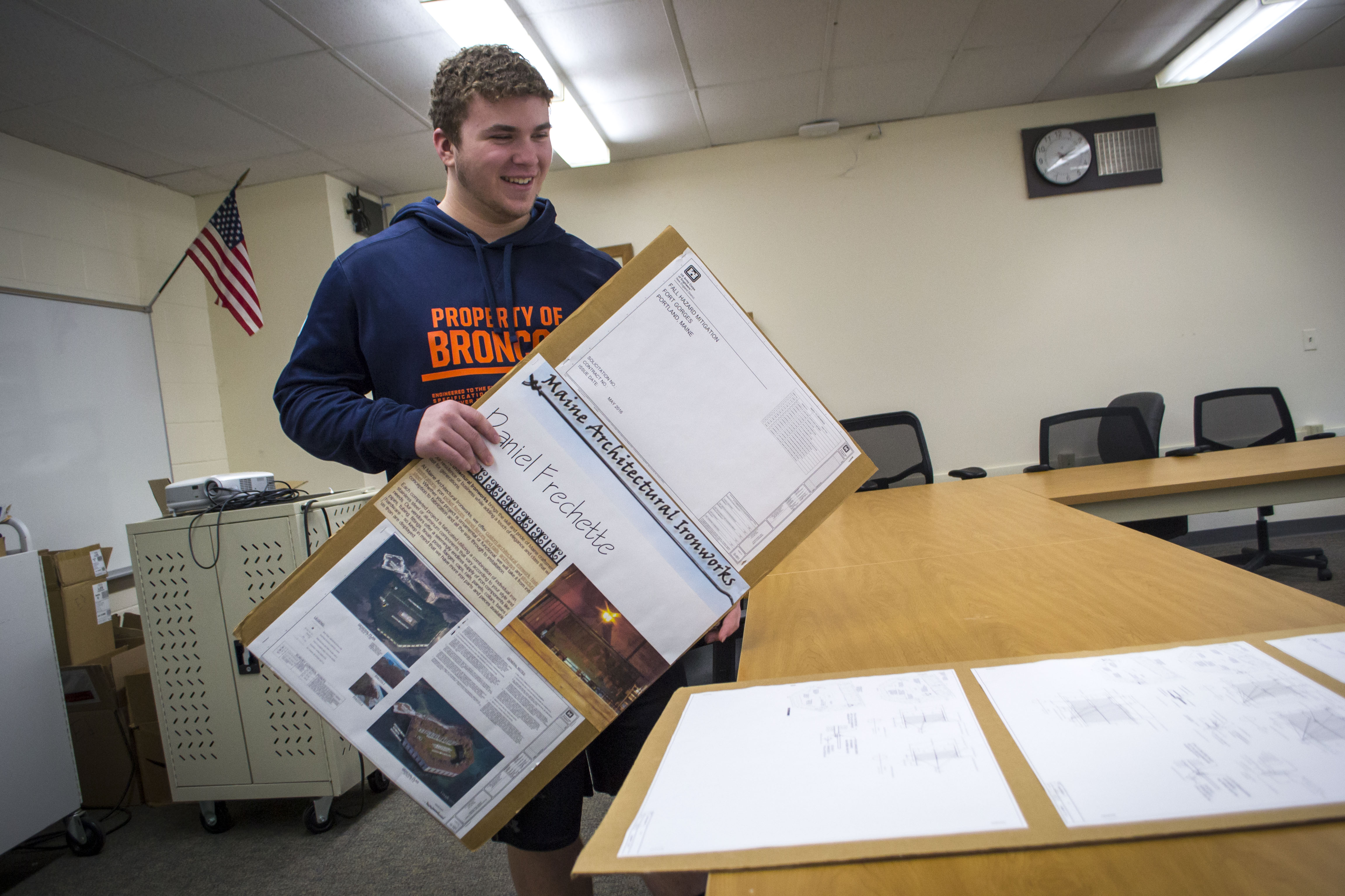 Daniel Frechette, 16, looks at his designs for gates and barricades that will be constructed and installed at Portland's Fort Gorges over the next several months. ALAN BENNETT/Journal Tribune