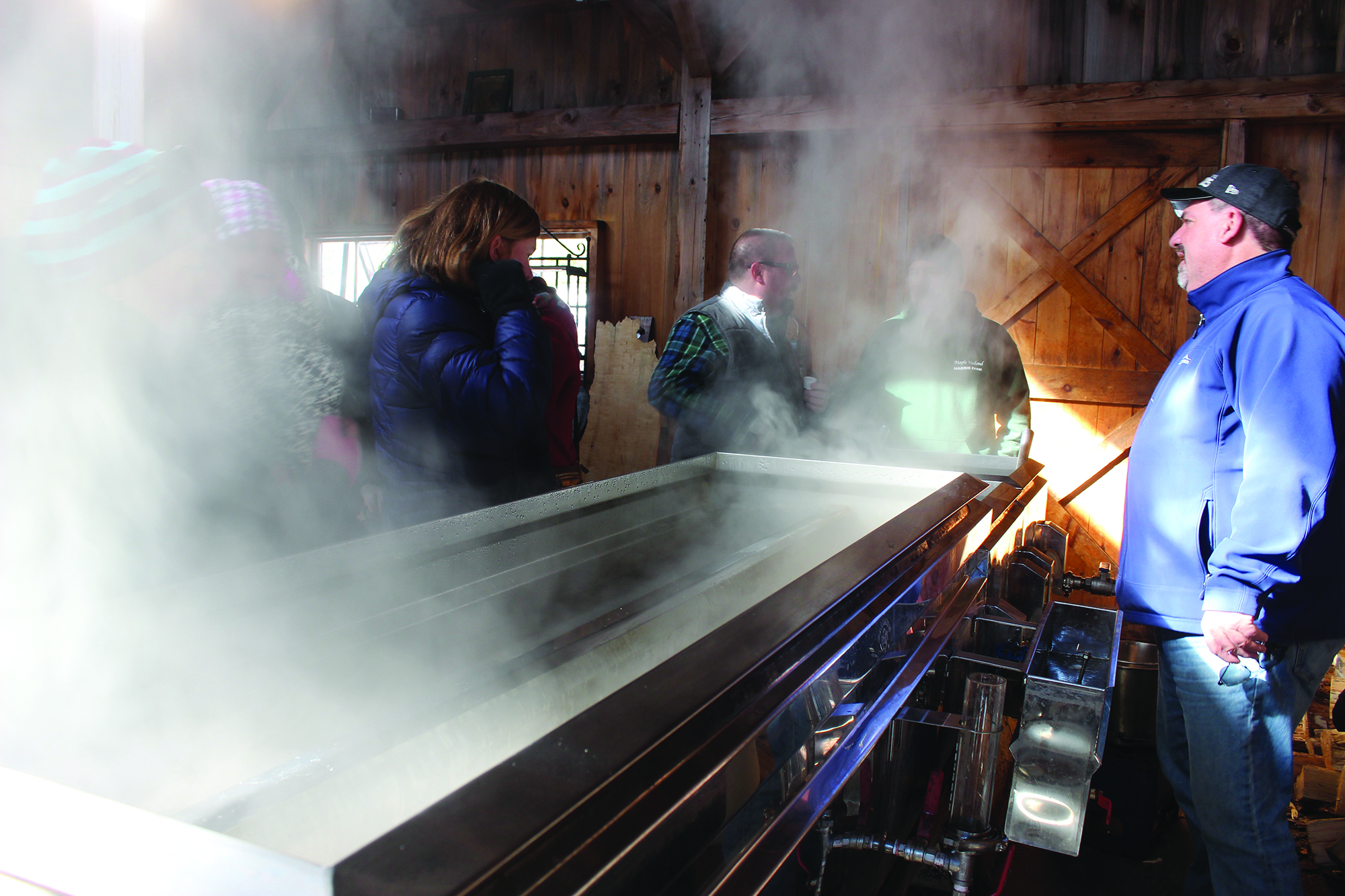 Sap boils in the evaporator at the Harris Farm sugarhouse on Sunday. RYDER SCHUMACHER/JournalTribune