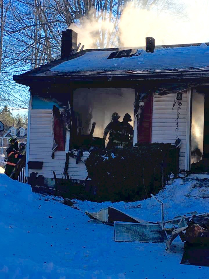 Firefighters  are shown here inside a home at 19 Harmon Ave. in Old Orchard Beach where they fought a blaze Saturday evening. The home, owned by Maurice and Barbara Doucette, was heavily damaged. One family member was treated for burns. COURTESY PHOTO/Perian Carpenter
