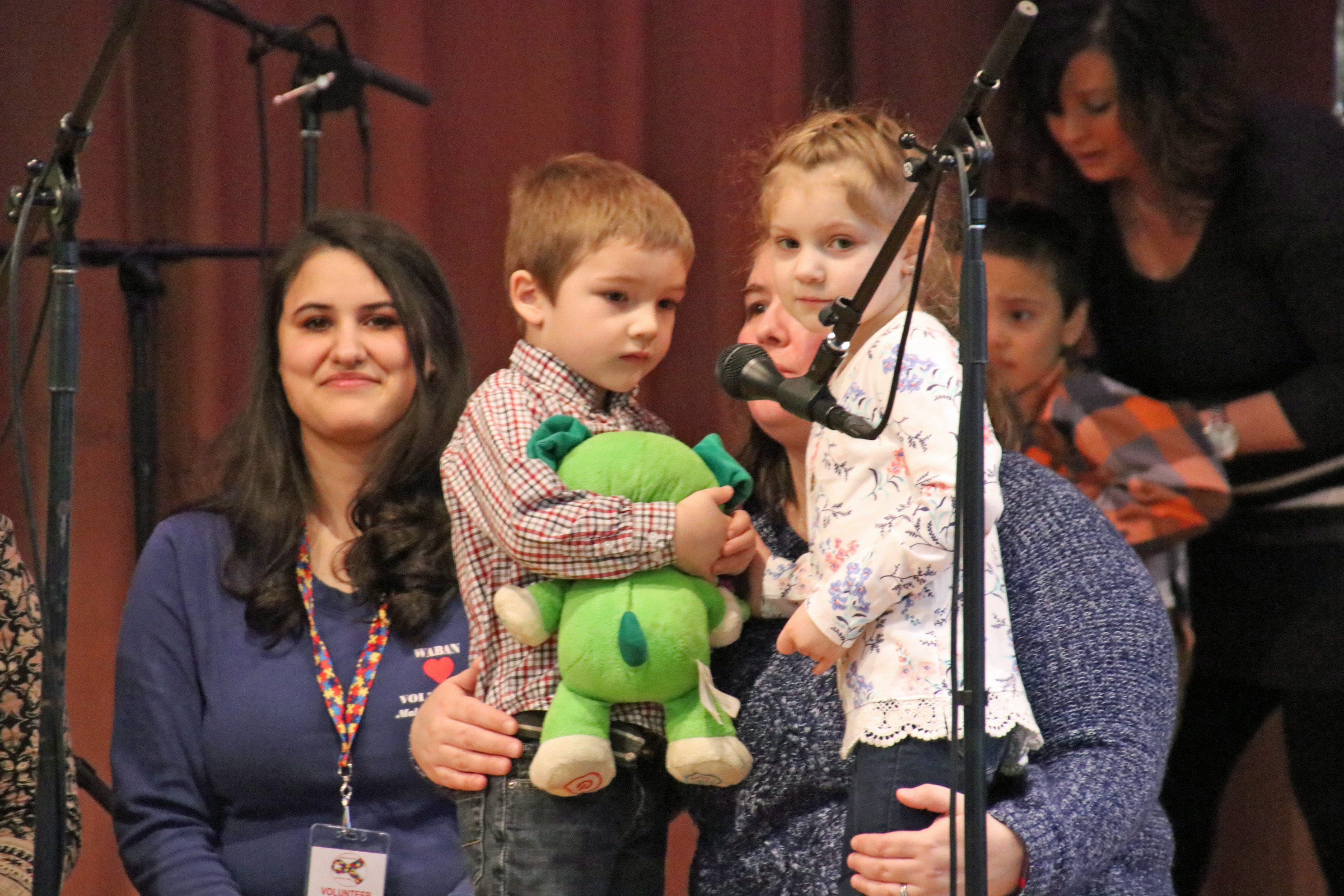 Noah Johnson, who attends Waban's preschool program, and his cousin Haley Eddows were on stage at St. Ignatius Gym at the Waban Telethon Saturday. The Telethon raised more than $88,000, which will go towards a new autism wing at the Fraser-Ford Child Development Center. TAMMY WELLS/Journal /Tribune