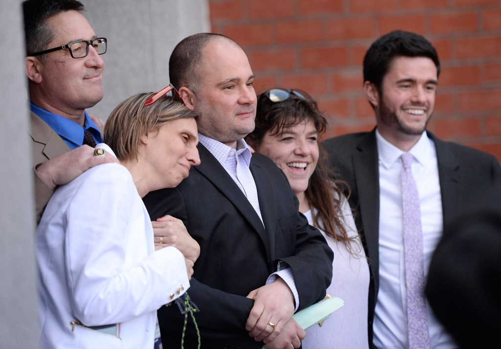 Michelle Sanborn, left, Anthony Sanborn Jr., and attorney Amy Fairfield celebrate after Anthony Sanborn is released on bail from Cumberland County Jail on April 13.