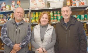 FROM LEFT, Aaron Park, Mid Coast Hunger Prevention Program Executive Director Karen Parker, and Paul Hollingsworth. Park and Hollingswoth, owners of Henry and Marty Restaurant and Catering in Brunswick, have held a fundraising dinner for 10 years for the agency.