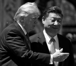 U.S. PRESIDENT DONALD TRUMP gestures as he and Chinese President Xi Jinping walk together after their meetings at Mar-a-Lago in Palm Beach, Florida. After decades of failure to stop North Korea's march toward a nuclear arsenal, some see Trump's bluster as a shrewd attempt to press China, the North's most important ally and trading partner, into pressuring North Korea more aggressively over its nuclear program.