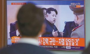 A MAN WATCHES A TV NEWS PROGRAM showing a file footage of North Korean leader Kim Jong Un, at Seoul Train Station in Seoul, South Korea today.