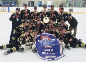 THE MAINE MOOSE U-18 SQUAD poses for a photo after winning the National Championship at Lansing, Mich., recently. The Moose defeated the New Hampshire Avalanche, 3-2, in the final. Brunswick area players Matthew Deveaux (U-18) and Michael Deveaux (U-16) competed in title games, with Matthew a member of the U-18 squad and Michael on the Maine Moose U-16 team. The U-16s competed in Dallas.