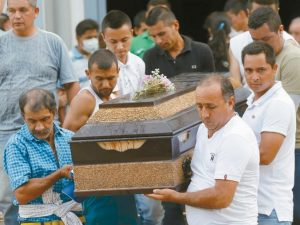 MEN CARRY THE COFFIN of a relative during a mass funeral in Mocoa, Colombia, Monday. The grim search continues for the missing in southern Colombia after surging rivers sent an avalanche of floodwaters, mud and debris through the small city, killing more than 260 people and leaving many more injured and homeless.