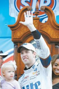 BRAD KESELOWSKI waves to fans after he won the NASCAR Cup Series auto race at Martinsville Speedway in Martinsville, Va., on Sunday.