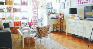 THIS PHOTO shows a room in a home with an acrylic chair.