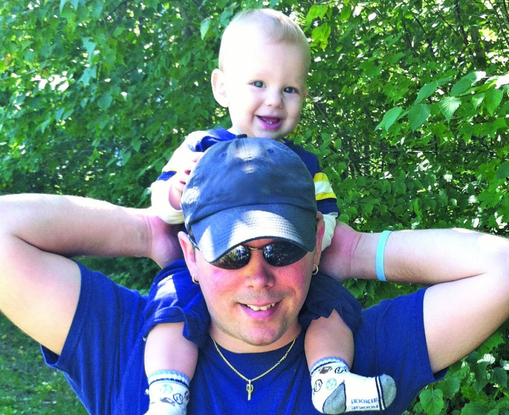 """Jake Roberts, shown with his son, Luc, is a """"master coach"""" in the Maine Boys To Men """"boot camp"""" for new dads."""