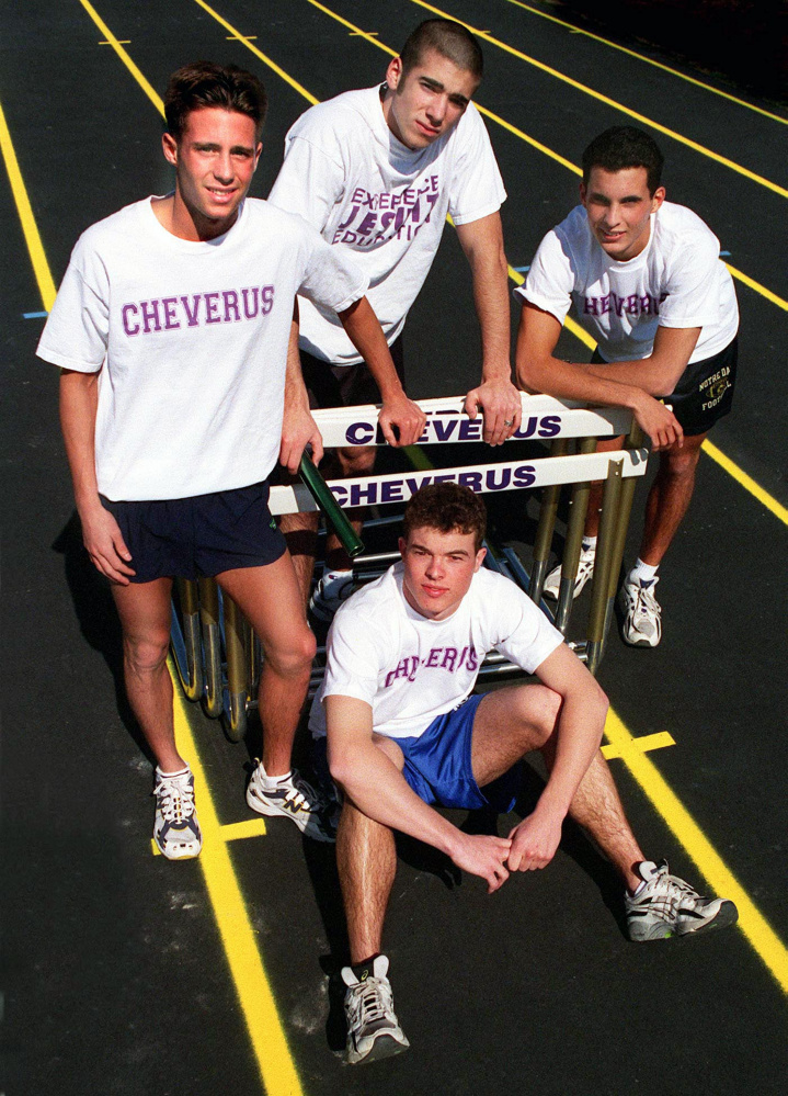 A Press Herald file photo shows Kyle Milliken (seated, front) with the state-record-setting Cheverus High School relay team in April 1998. Also pictured, standing from left, are Ryan Toothaker, Nick Nappi, and Ryan Demers.