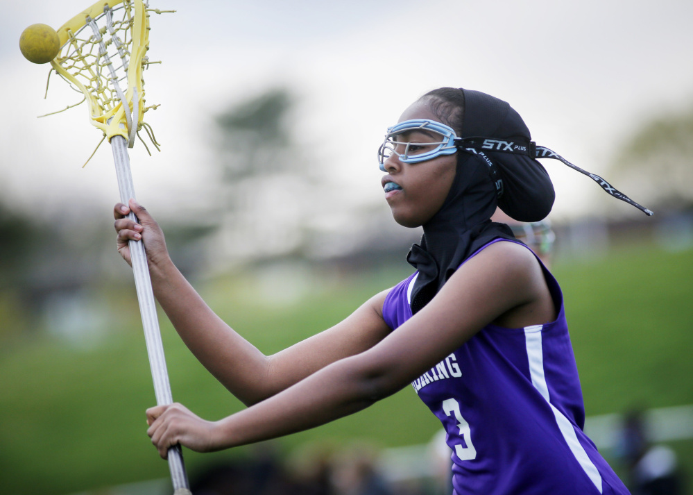 "Fadumo Adan, a lacrosse player at Deering High, wears a sports hijab provided by the school. ""It's just another part of the uniform,"" according to the Minnesota manufacturer."