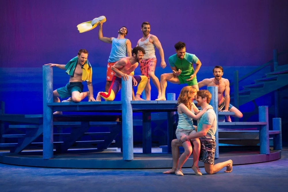 "Briana Rappa as Sophie, Mike Heslin as Sky, and the cast of ""Mamma Mia!"" The production opens the 85th season at the Ogunquit Playhouse."
