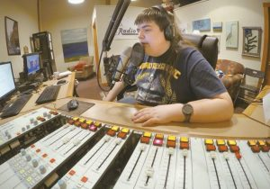 CHAZ WING records the weather forecast at a radio station in Brunswick, in this March 18 photo. Wing has testified that he was raped by other kids three times in junior high.