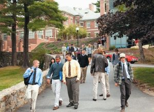 STUDENTS WALK between classes last fall at Hyde School in Bath. The school announced Monday that it is closing its sister school in Woodstock, Connecticut, and spending funds on expansion at the Bath campus.