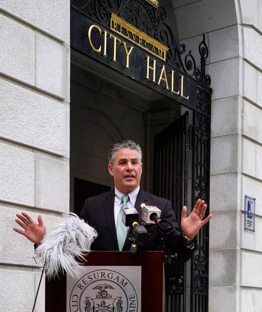Mayor Ethan Strimling holds a news conference outside Portland City Hall on Monday to announce the creation of a task force to study the city's charter.