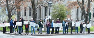 ACTIVISTS WITH SAGADAHOC INDIVISIBLE gathered in Bath on Saturday to call for an independent investigation into the Trump campaign's relationship with Russia and protest against the president's health care legislation.