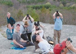 BIRDERS CATCH SIGHT of hawks on Saturday during the Bradbury Mountain State Park hawk watch, which runs to May 15.