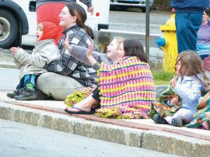 THESE YOUNGSTERS are staying warm while enjoying the Bath Memorial Day Parade on Monday.