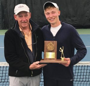 MT. ARARAT HIGH SCHOOL tennis player Nick Mathieu, right, poses with Eagles coach Don Foley and the 2017 MPA Schoolboys trophy at the Racket & Fitness Center in Portland on Monday. Mathieu won his second consecutive singles tennis title, downing Falmouth's Nick Forester.