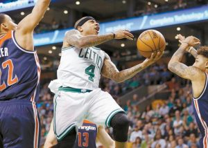 BOSTON CELTICS' Isaiah Thomas (4) goes up to shoot against Washington Wizards' Otto Porter Jr. (22) during the second quarter of a second-round NBA playoff series basketball game on Sunday in Boston. The Celtics won, 123-111.