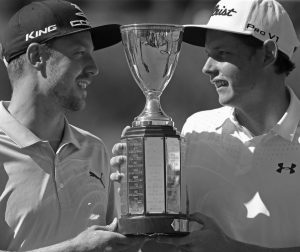 JONAS BLIXT, LEFT, and teammate Cameron Smith hold up their tournament trophy after they won a sudden-death playoff for the PGA Zurich Classic golf tournament's new two-man team format at TPC Louisiana in Avondale, La. on Monday. The pair defeated Kevin Kisner/Scott Brown.