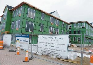 BRUNSWICK STATION APARTMENTS construction nears completion and will house 24 residential units, with rents ranging from $1,200-$1,500 a month. Occupancy begins this summer.