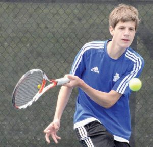 MORSE'S MATTHEW JARMUSZ watches his shot during the MPA Schoolboys Tennis Championships at Colby College in Waterville on Saturday.