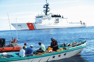 A U.S. COAST GUARD law enforcement team from the USCG cutter Stratton boards a small fishing boat that was stopped carrying close to 700 kilos of pure cocaine in the Pacific Ocean hundreds of miles south of the Guatemala-El Salvador border. Hidden in the bales of cocaine was a GPS tracking device wrapped inside a condom, a sure sign the drug bosses behind the shipment knew right away it didn't reach its destination.