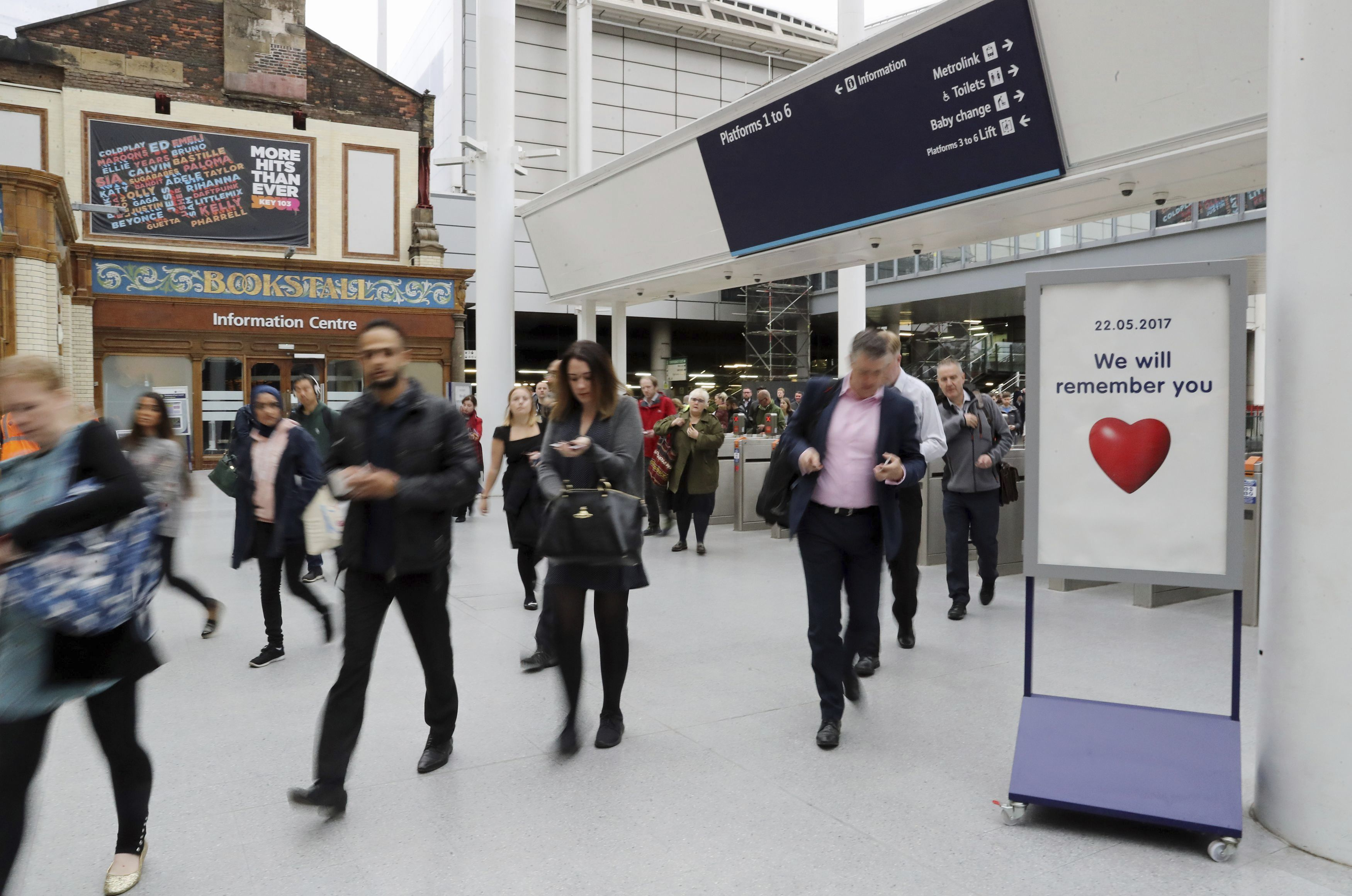 Commuters pass through Manchester Victoria railway station, England, on Tuesday, which has reopened for the first time since the terror attack on the adjacent Manchester Arena. The station closed was closed following the explosion last week that killed more than 20 people. AP WIREPHOTO