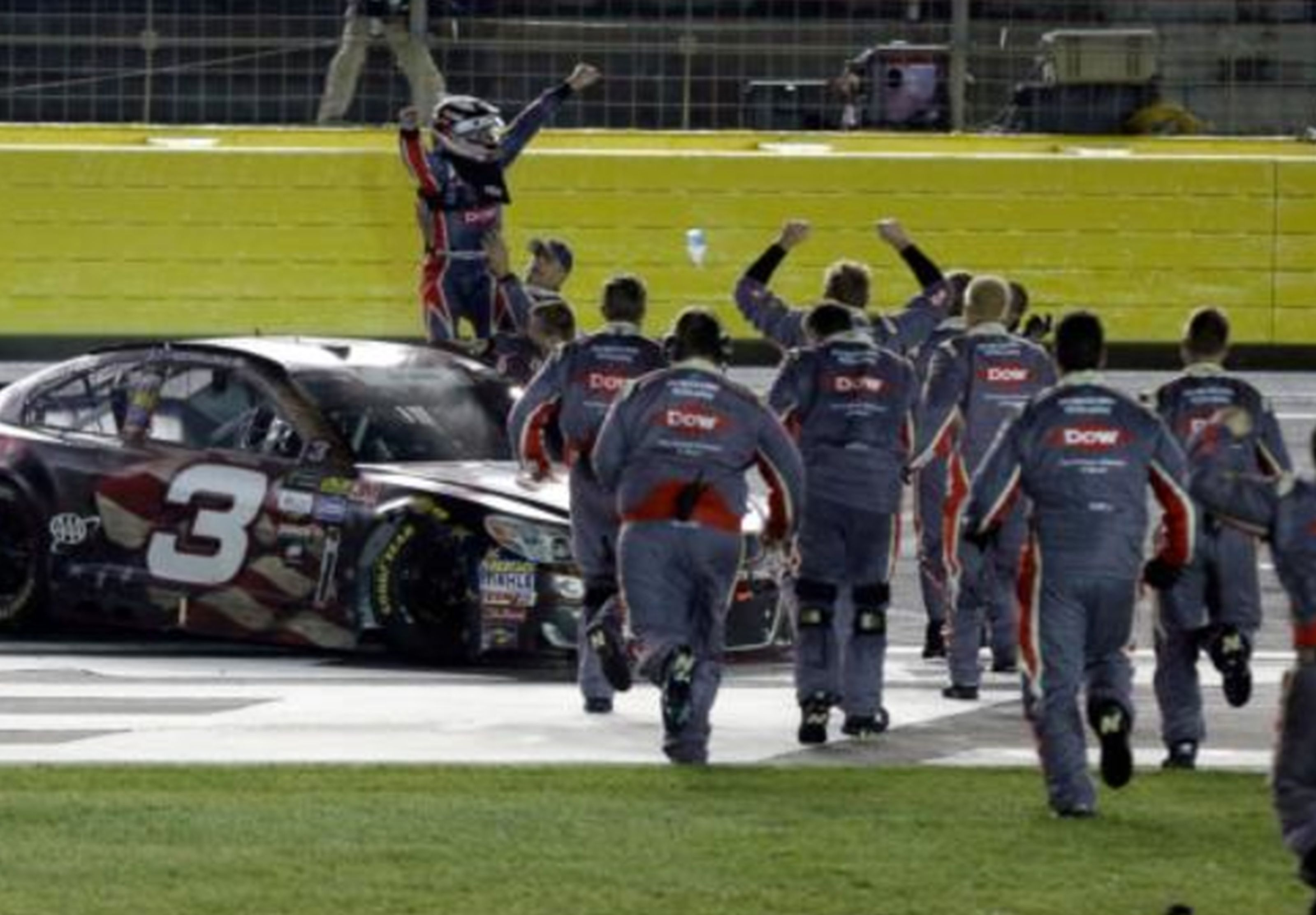 Austin Dillon, left, celebrates with his crew after winning the NASCAR Cup series auto race at Charlotte Motor Speedway in Concord, N.C. AP WIREPHOTO/Chuck Burton)