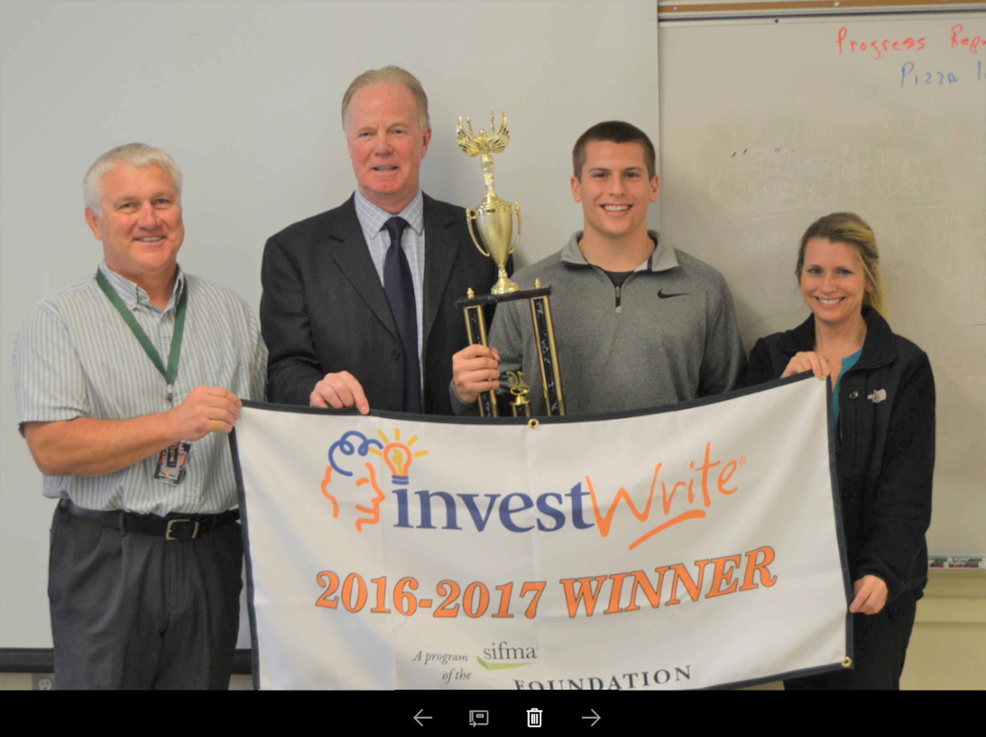 Austin Dutremble, a senior at Biddeford Regional Center of Technology and Biddeford High School, was named the state winner of the SIFMA Foundation's Fall 2016 InvestWrite® essay competition. From left are BRCOT Instructor Ken Crepeau, ME/NH Coordinator for InvestWrite Jim Ford, BHS Senior Austin Dutremble and his mother Tracy Dutremble. SUBMITTED PHOTO
