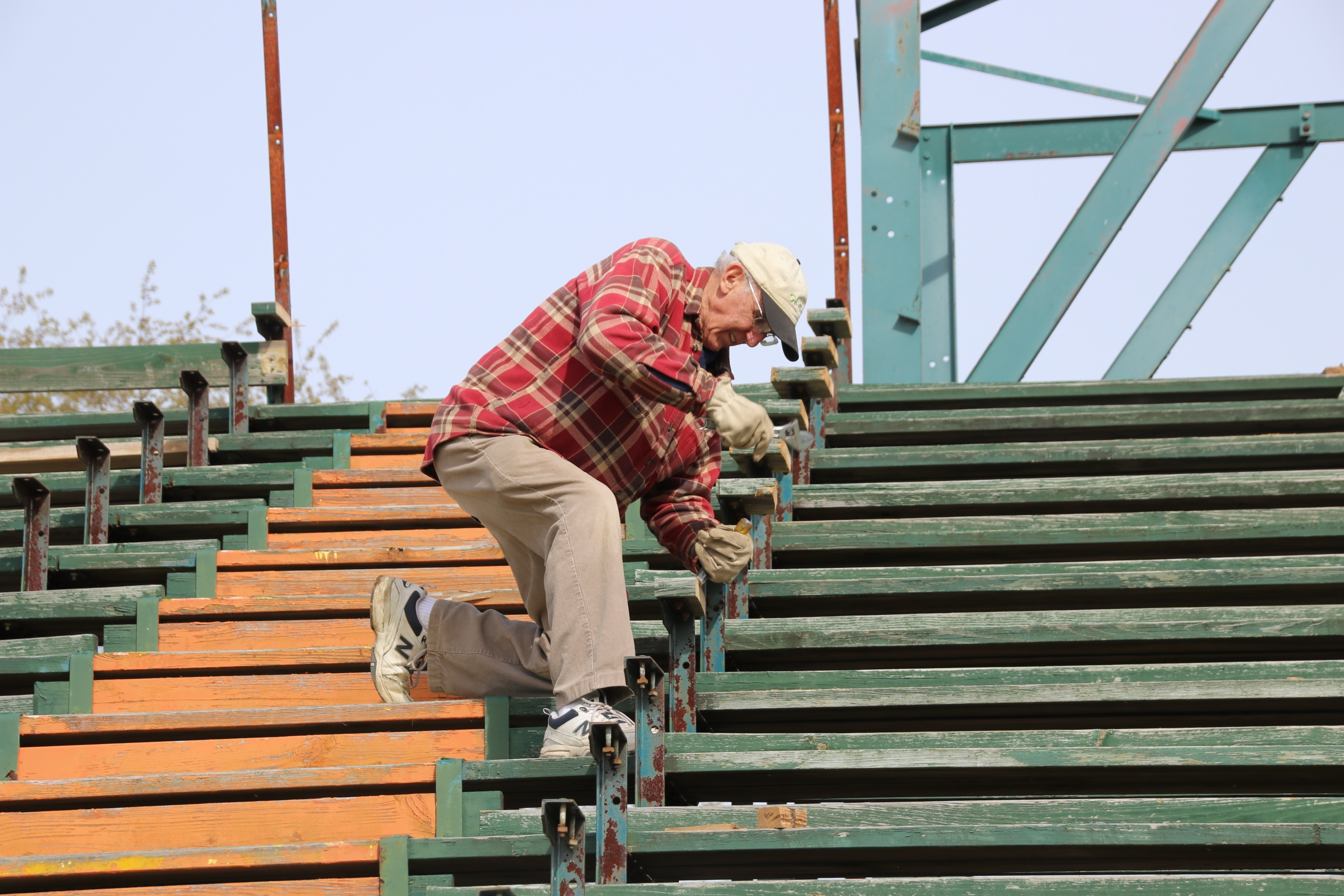 Phil Laverriere was among those doing his bit Saturday, helping dismantle the old bleachers at Waterhouse Field in Biddeford. TAMMY WELLS/Journal Tribune