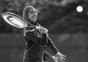 TABAREK KADHIM, a sophomore at Deering High School in Portland, Maine, wears a sports hijab while playing a tennis match in Windham, Maine. Deering High School is providing sport hijabs with the goal of making Muslim girls comfortable and boosting their participation in sports. Tennis co-captains Liva Pierce and Anaise Manikunda solicited private donations to avoid criticism for using taxpayer funds on religious apparel, and ended up with enough to outfit all teams, including lacrosse, soccer, volleyball, softball, field hockey and track.