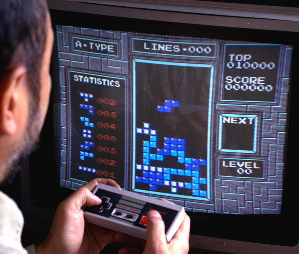 "A Nintendo gamer plays ""Tetris"" in this photo from June 1990. This weekend, audiences will pack a concert hall in Paris to hear the London Symphony Orchestra performing videogame music."