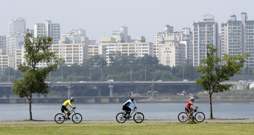 Cyclists ride along the Han River in Seoul, South Korea, on June 15. The nation's multimillion-dollar network of bike paths winds through urban and rural areas, covers 1,677 miles so far – and is still under construction.