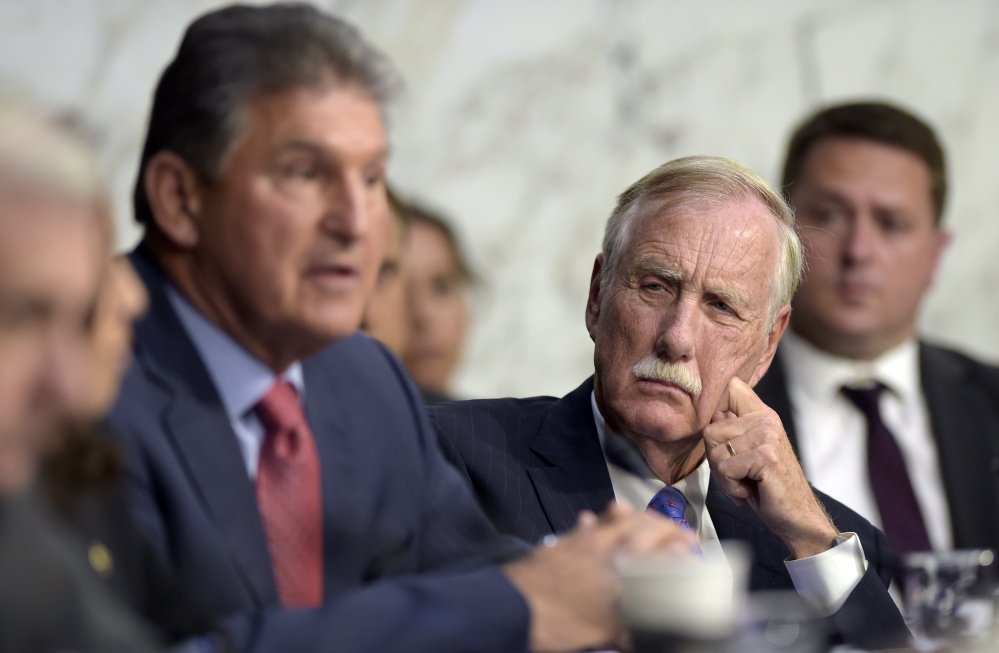 Sen. Angus King, an independent from Maine who caucuses with Democrats, listens as Sen. Joe Manchin, D-W.Va., asks a question during a Senate Intelligence Committee hearing about the Foreign Intelligence Surveillance Act on Capitol Hill in Washington on June 7. King says meddling by Russia in the 2016 U.S. election isn't getting enough scrutiny.