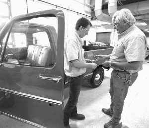 NATHANIEL ESKEW, left, who comes from a car family, works on a truck in the Workforce Development Institute building at Richland Community College in Decatur, Illinois. Eskew received the truck from his great-grandfather and restored it with the help of his classmates and family.