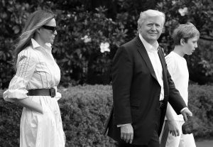PRESIDENT DONALD TRUMP, first lady Melania Trump, and their son and Barron Trump, walk to Marine One across the South Lawn of the White House in Washington Saturday en route to Camp David in Maryland.