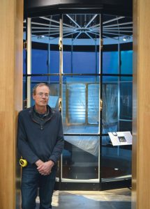 MAINE MARITIME MUSEUM Curator of Exhibits Christopher Hall, pictured here, has worked with his team over the past several months to recreate the east tower of Two Lights inside the Bath facility to house that lighthouse's original second-order Fresnel Lens.
