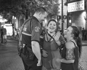 AUSTIN POLICE Lt. Dustin Lee talks to Amanda Patrick and Abby Sutton, right, while patrolling Sixth Street in Austin, Texas.