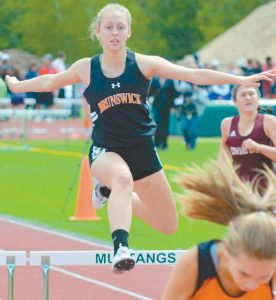 EMILY LAROCHELLE of the Brunswick High School track and field team leaps over a hurdle during the 300-meter hurdle race at the State Class A Track and Field Championships on Saturday.