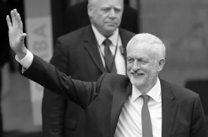 BRITAIN'S LABOUR PARTY LEADER JEREMY CORBYN waves as he leaves the Labour party headquarters in London, Friday. British Prime Minister Theresa May's gamble in calling an early election backfired spectacularly, as her Conservative Party lost its majority in Parliament and pressure mounted on her Friday to resign.