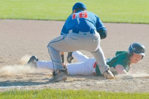 KAILEB HAWKES of the Highland Green Senior American Legion baseball team dives back into first base during Tuesday's game with Yankee Ford. Hawkes was the lone repeat hitter for Highland Green as the hosts fell, 6-1.