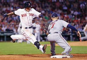 BOSTON BASE RUNNER Tzu-Wei Lin is forced out by Minnesota Twins first baseman Joe Mauer (7) during the seventh inning of a baseball game at Fenway Park in Boston on Monday. The Red Sox won, 4-1.