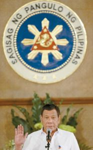 PHILIPPINE PRESIDENT RODRIGO DUTERTE raises his hands as he officiates the swearing in of municipal leaders at the Malacanang presidential palace in Manila, Philippines today.